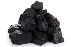 Coal lumps. Stack of coal lumps on white background Stock Images
