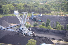 Coal mine. Aerial view of industrial machines working in coal mine Royalty Free Stock Photography