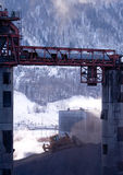 Coal mine. A large bulldozer pushing coal in a coal mine Royalty Free Stock Images