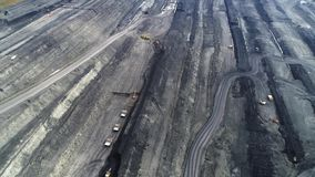 Coal mine, aerial view. Coal mine aerial view. Development of coal seams using explosions and excavators stock video
