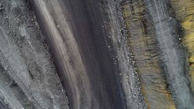 Coal mine, aerial view. Road for the movement of mining trucks. Ways to transport minerals to the surface of the earth stock footage