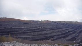 Coal mine, aerial view. Coal mine aerial view. Opencast coal mining. Deep and long quarry stock footage