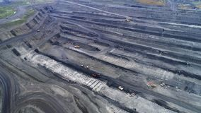 Coal mine, aerial view. Coal mine aerial view. Opencast coal mining. Deep and long quarry stock video