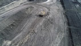 Coal mine, aerial view. Road for the movement of mining trucks. A heavy mining dump truck takes overburden to the dump stock video