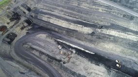 Coal mine, aerial view. Road for the movement of mining trucks. Ways to transport minerals to the surface of the earth stock video
