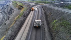 Coal mine, aerial view. Road for the movement of mining trucks. Ways to transport minerals to the surface of the earth stock video footage
