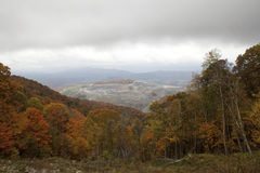 A coal mine, Appalachia, America. View through autumn trees of a coal mine in Appalachia stock photo