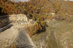 Coal Mine Appalachia. Coal mine in Appalachia surrounded by forest in autumn colours royalty free stock photos