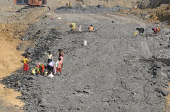 Coal Mine. BIRBHUM- JANUARY 19: Local residents of a nearby village stealing coal in broad daylight from a local coal mine in Birbhum, India on January 19, 2011 Stock Photo