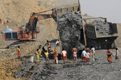 Coal Mine. BIRBHUM- JANUARY 19: People indulging in stealing coal in broad daylight from a local coal mine in Birbhum, India on January 19, 2011 Royalty Free Stock Photos