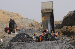 Coal Mine. BIRBHUM- JANUARY 19: People stealing coal in broad daylight from a local coal mine in Birbhum, India on January 19, 2011 Royalty Free Stock Images