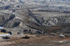 Coal mine with excavator machine Stock Photos