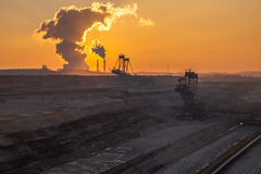 Coal mine. Excavator and Coal power plant cloud of smoke Royalty Free Stock Photo