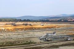 Coal mine with excavators Stock Image