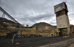 Coal mine and rail tracks near Somerset, Colorado. Train tracks in the foreground of an old coal mine near Somerset, Colorado on an overcast day royalty free stock images