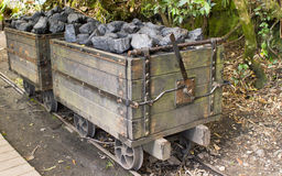 Coal mine. Railway cargo cars carrying coal in 19th century in coal mine in Australia royalty free stock images