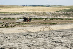 Coal Mine Reclamation. Backfilling and topsoil restoration at a coal mine in Wyoming Royalty Free Stock Images