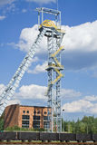 Coal mine. Shaft tower of a coal mine with mining cars Stock Image