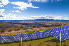 Coal mine with solar energy panels. Industrial place stock photo