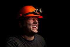 Coal miner. On a black background stock photos