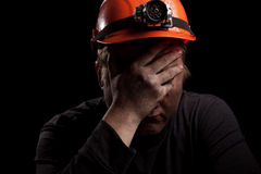 Coal miner. On a black background Stock Images