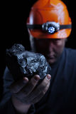 Coal miner. On a black background royalty free stock photos