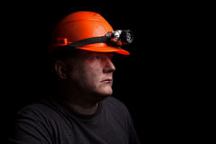 Coal miner. On a black background Stock Photography