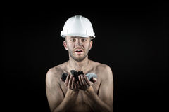Coal miner on a black background Stock Images