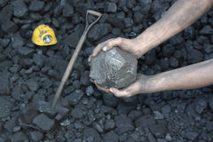 Coal. Miner holding a stone Stock Images