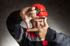 Coal miner looking through a finger frame Stock Photos