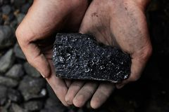 Coal miner in the man hands of coal background. Coal mining or e Royalty Free Stock Images