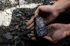 Coal miner in the man hands of coal background. Coal mining or e Stock Images