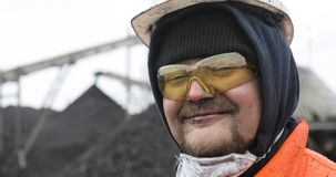 Coal miner, portrait of a young miner or stoker in the workplace.