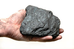 Coal in miner's hand stock photography