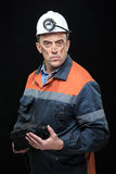 Coal miner showing lump of coal with thumbs up Stock Photos