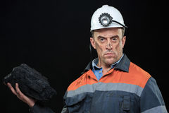 Coal miner showing lump of coal with thumbs up Royalty Free Stock Photo