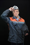 Coal miner showing lump of coal with thumbs up Royalty Free Stock Image