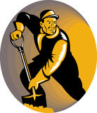 Coal miner or stoker with shovel Royalty Free Stock Image