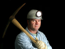 Coal Miner With Pickax - In The Dark Royalty Free Stock Photo