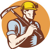 Coal miner at work with pick ax Royalty Free Stock Images