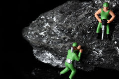 Coal miniature miners Stock Image
