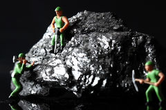 Coal miniature miners Royalty Free Stock Image