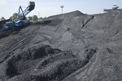 Coal mining. Loader in open-cast mine Stock Photos