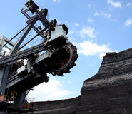 Coal mining with big excavator Stock Photos