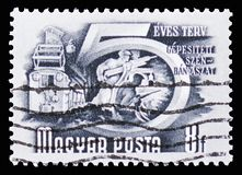 Coal mining, Five-Year Plan serie, circa 1950. MOSCOW, RUSSIA - SEPTEMBER 15, 2018: A stamp printed in Hungary shows Coal mining, Five-Year Plan serie, circa stock photography