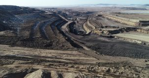 Coal mining russia. Coal mining open pit russia aerial view landscape stock video footage