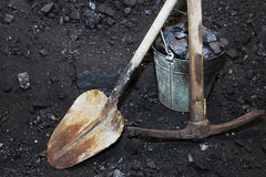 Coal mining. Shovel with a pickaxe and the bucket in mine Stock Image