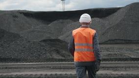 Coal mining worker man walk. Black fuel stock video footage