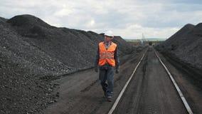 Coal mining worker man walk. Black fuel stock footage