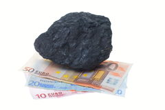 Coal nuggets and banknote royalty free stock photography